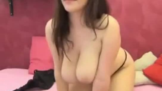 Sexy milf with big tits fingers her pussy